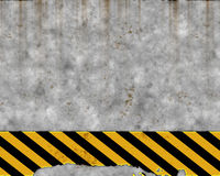 Old hazard concrete wall. An old yellow and black hazard striped sign on a grungy concrete wall stock illustration