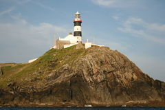 Old Head Lighthouse. Old Head Light House from the sea Stock Photography