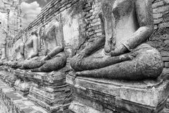 Old headless broken buddha statue at Ayutthaya Thailand in black Royalty Free Stock Photography