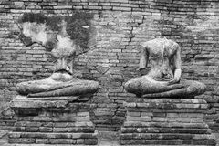 Old headless broken buddha statue at Ayutthaya Thailand in black Royalty Free Stock Images