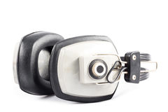 Old headphones isolated Royalty Free Stock Images
