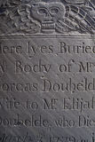 Old headstone. Macro view of inscription on old sculpted gravestone from eighteenth century stock image