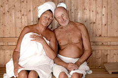 Old healthy lifestyle. Seniors couple relaxing in sauna royalty free stock image