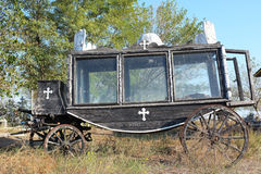 Old hearse. Old coach hearse in a grave yard Royalty Free Stock Photography