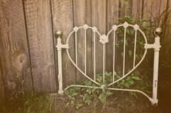 Old heart-shaped white wrought iron headboard Stock Photos