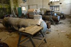 Old heat exchange equipment. Premises of a destroyed and plunder. Ed milk production plant. The raiders captured the plant. Vandalism. Ukraine, January 2018 Stock Image