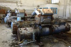 Old heat exchange equipment. Premises of a destroyed and plunder. Ed milk production plant. The raiders captured the plant. Vandalism. Ukraine, January 2018 Stock Photos