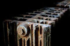 Old heater. Very old heater at an abandoned coal mine - rusted, corroded Stock Image