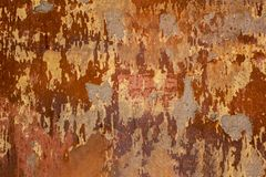 Old heavily damaged concrete red wall with patches of gray cement. rough surface texture. A old heavily damaged concrete red wall with patches of gray cement royalty free stock photo