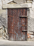 Old, heavily weathered, brown wooden door Royalty Free Stock Photography