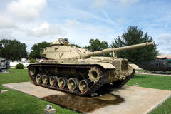 An old, heavy-duty tank on display Stock Image