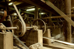Old heavy machine wheel working by hot steam in ancient traditio Stock Photography