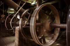 Old heavy machine wheel working by hot steam in ancient traditio Royalty Free Stock Photo