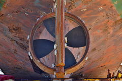 Old heavy ship& x27;s propeller & x28;screw& x29; of the rusty shipwreck vessel in the dry dock Stock Images