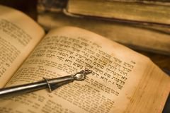 Old hebrew bible and pointer. Old hebrew bible book and antique silver pointer Stock Image