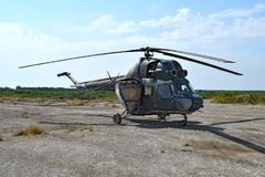 Old helicopter spraying fields. Helicopter spraying fertilizer stock photo