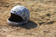 Old helmet abandon on the ground Royalty Free Stock Photo