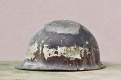 Old helmet of miner. Macro detail of old and dusty miner helmet Royalty Free Stock Photography
