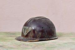 Old helmet of miner. Macro detail of old and dusty miner helmet Royalty Free Stock Image