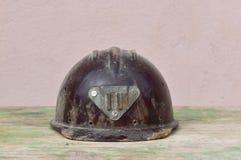 Old helmet of miner. Macro detail of old and dusty miner helmet Royalty Free Stock Photo