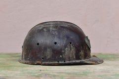 Old helmet of miner. Macro detail of old and dusty miner helmet Stock Images