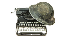 Old helmet on the old typewriter. Stock Photo