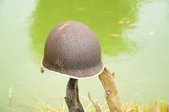 Old helmet. Old steel helmet on water background Royalty Free Stock Photos