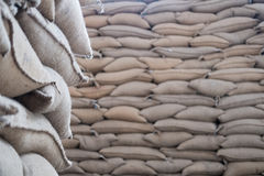 hemp sacks containing coffee bean in warehouse. stacked sacks in Royalty Free Stock Photography