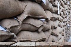 hemp sacks containing coffee bean in warehouse. stacked sacks in Royalty Free Stock Photo