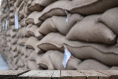 hemp sacks containing coffee bean in warehouse. stacked sacks in Royalty Free Stock Photos