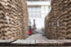 hemp sacks containing coffee bean in warehouse. stacked sacks in Stock Photo