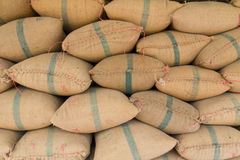 Old hemp sacks containing rice. Placed profoundly stacked Stock Images