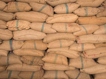 Old hemp sacks stacked in a row. Royalty Free Stock Images