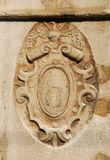 Heraldic emblem in Venice. Old heraldic emblem relief on a Venice wall royalty free stock photo