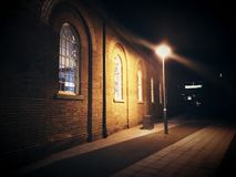 Old heritage building with arched windows under street light Stock Photos