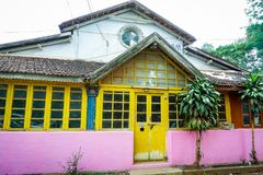 An old heritage house in Yercaud, Tamil Nadu. A colorful house with beautiful windows and door in Yercaud hill station, Tamil Nadu Royalty Free Stock Photography