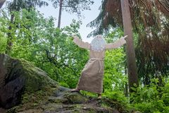 The old hermit lifted up his hands to the sky. Stock Photography