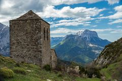Old hermitage & the mountains green grass royalty free stock photos