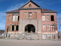 Old High School Building. Once the pride of a town, an old high school building has fallen into disrepair and decay Stock Images