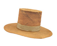 Old high-top straw hat isolated. Royalty Free Stock Photography