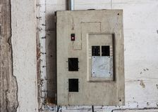 Old High voltage cabinet. On the concrete wall Stock Photos