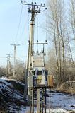 Old high-voltage transformer. Installed right on the street. Electrical industry. Stock Image