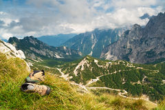 Old hiking boots in mountains Stock Photos