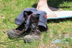 Old hiking boots with untied laces stand royalty free stock images