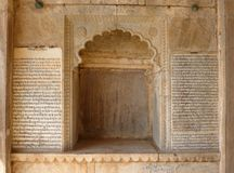 Old hindu scriptures on palace wall Stock Photos