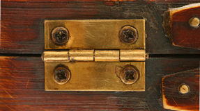 Old hinge. On wooden background Stock Images