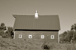 Old hip roof barn with a lone cupola Stock Photography