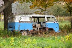 Old hippie van. Old abandoned hippie van on a farm Royalty Free Stock Photos