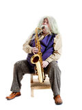 Old hippies saxophonist. Carved on a white Stock Photos