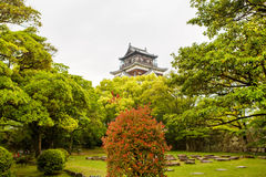 Old Hiroshima casle in Japan, on Otagawa river in summer. Royalty Free Stock Images